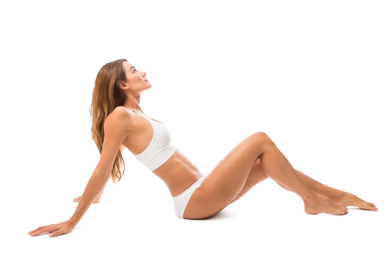 Woman model in underwear leaning back