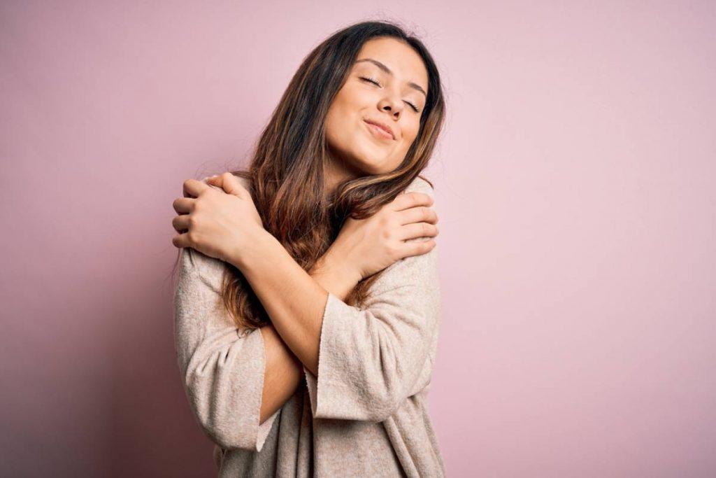 happy woman after breast augmentation procedure.